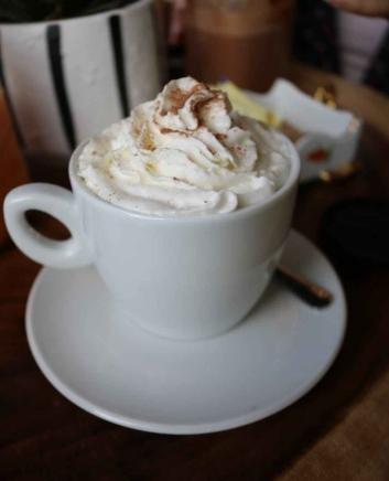 white ceramic cup with white cream