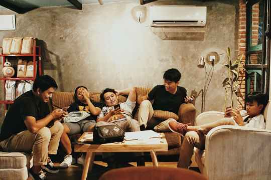 men sits of sofa